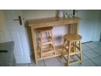 Wooden breakfast table/bar and two stools in excellent condition. Originally from John Lewis.