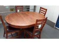 Round Dark wood Extending Dining table & 4 Designer Kember chairs