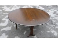 Circular folding dining table