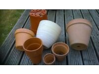 A collection of clay pots, one ceramic and one other