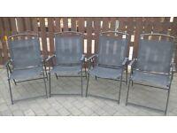 4 black garden chairs