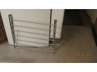 space-saving stainless steel clothes drying/airing rack that fold flat when not in use