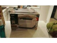brand new in box Asda pink and silver 4 slice toaster