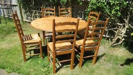 Oval pine table and 6 chairs