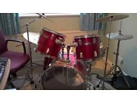 Kestrel 5 piece drum kit, cybals, stands, stool, drum sticks, music and ear defenders