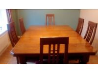 Beautiful wood dining table with chairs
