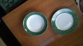 white plates and dishes with dark green edging