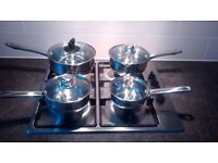 4 brand new stainless steel pans with 3 glass lids. Stove not included !