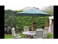 Hardwood 1.5 metre circular outdoor table and four cushioned recliner / upright chairs