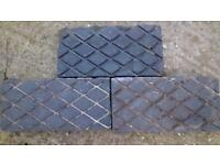 Black, lozenge pattern decorative bricks.