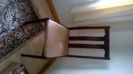 extending mahogany dining table and four chairs and matching display lounge unit