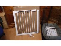 Safety Gate new Unpacked but never used. Pressure fitting with button opening.