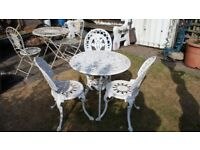ORNATE CAST GARDEN TABLE A THREE CHAIRS