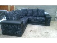 "Corner Sofa half leather & material, ""Brand New & Unused"" black & white, can be delivered soon as."