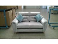 Brand new 2 seat sofa in light grey fabric