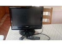 """TECHNIKA 19"""" TV WITH BUILT IN FREE VIEW, DVD PLAYER AND IPOD DOCKING STATION."""