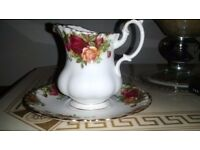 Royal Albert milk jug and saucer. old country roses