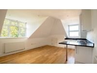 Stunning top floor flat in Queens Park, near the station.