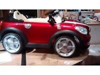 Electric ride on red metallic mini (6 volt)