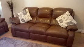 Brown leather reclining suite excellent condition.