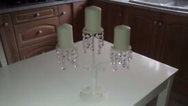 Metal and faux crystal candelabra with three candles.