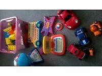 bundle of toys, educational laptop, zing-zilla guitar, alphabet singing bus, globe, cars etc.