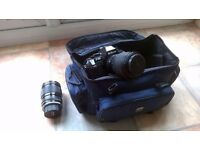 Nikon F-301 camera with lens and bag