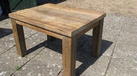 Rustic wooden dining table. 4ft x3 ft . Very heavy and solid. Used under a year.