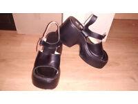 Black platform sandals (size 4)