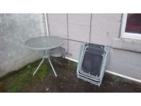 Garden table + 4 chairs + barbecue