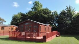 Holiday Lodge for sale at Yaxham Waters Holiday Park set in woodland at the rear & fishing lakes