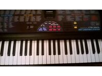 Casio CTK 560L electronic keyboard with power lead. Music book included. Plus key lighting system.