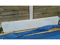 Concrete fence post and gravel boards