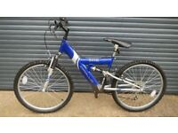 CHILDS APOLLO EXCEL SUSPENSION BIKE IN EXCELLENT USED CONDITION. (SUIT APPROX. AGE. 9+)..