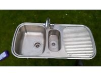 One and a half bowl, stainless steal sink with mixer tap and waste.