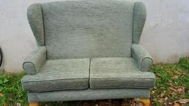 Two seater as new HSL pale green wng backed sofa