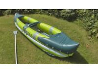 Inflatable kayak with bag and paddles