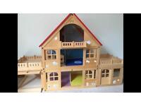 Childrens wooden doll house with loads accessories, families, pets and car