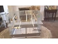 """Extremely large bird cage only 4 months old, 31 long, 18""""wide, 25 """"high."""