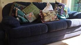 Three seater sofa, two armchairs and foot stool