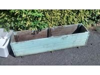EX LONG WOODEN PLANTER MEASURES APPROX 29 CM WIDE X 125 CM LONGX 34 DHIGH