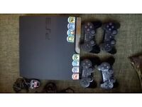 Sony PlayStation 3 (PS3) console, 4 controllers and 8 games and action figures (Skylanders)