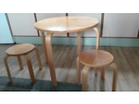 childs small table and two matching stools