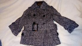 A beautiful black and white Zara coat 3/4 sleeves size S