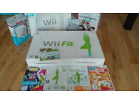 Nintendo Wii including Wii Fit Balance Board and several fitness/sports games