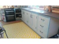 Framed solid wood shaker kitchen units and worktop