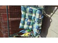 For sale garden swing with cushions.