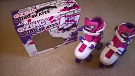 Girls' roller skates, adjustable size 13- 3, with set of arm, knee, elbow pads