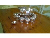 Silver punch bowl with 12 cups plus ladle