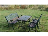QUALITY AND HEAVY ORNATE GARDEN TABLE, CHAIRS AND BENCH NEED WORK/NEW WOOD